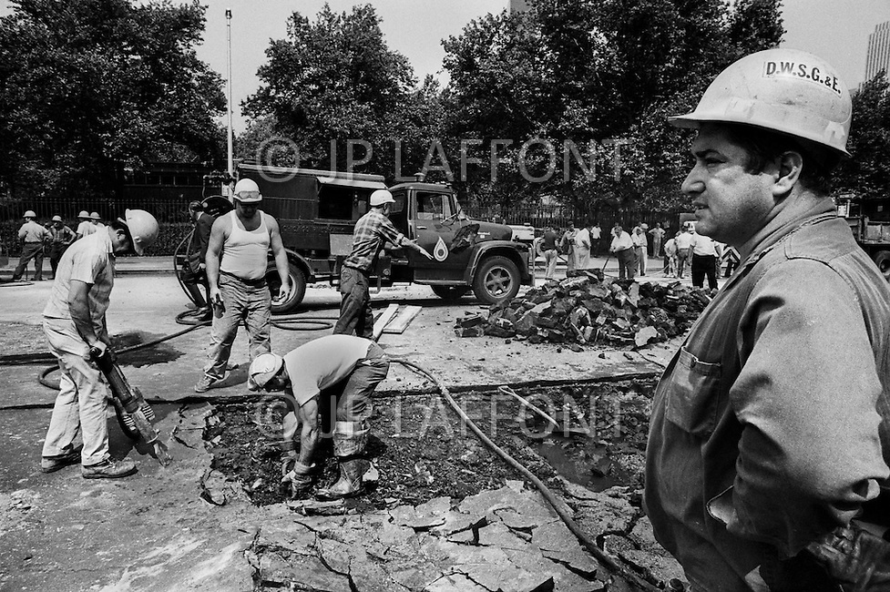 Manhattah, NYC, Summer 1966. Repair of the water pipes on 1st Ave. in front of Con Edison's power plant.