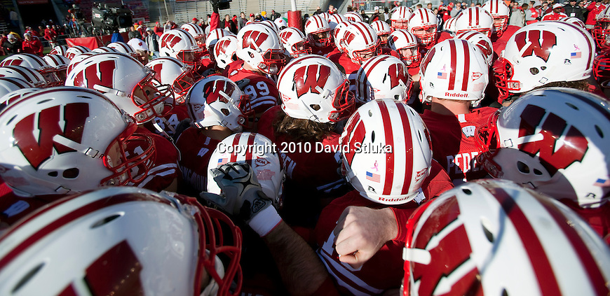 Wisconsin Badgers huddle prior to an NCAA college football game against the Northwestern Wildcats on November 27, 2010 at Camp Randall Stadium in Madison, Wisconsin. The Badgers won 70-23. (Photo by David Stluka)
