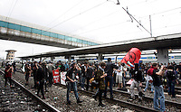 Studenti occupano alcuni binari della Stazione Ostiense, al termine di una manifestazione, a Roma, 7 ottobre 2011..Students occupy some railway line at the Ostiense station, at the end of a demonstration, in Rome, 7 october 2011..UPDATE IMAGES PRESS/Riccardo De Luca