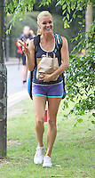EXCLUSIVE ALL ROUND PICTURE: MATRIXPICTURES.CO.UK<br /> PLEASE CREDIT ALL USES<br /> <br /> WORLD RIGHTS<br /> <br /> Former world number 1 Belarusian professional tennis player Victoria Azarenka is spotted looking relaxed and happy as she leaves the practice courts at Wimbledon in preparation for nest week's Wimbledon Championships in London.<br /> <br /> JUNE 21st 2013<br /> <br /> REF: MTX 134251