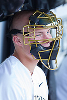 Jimmy Redovian (23) of the Wake Forest Demon Deacons dons a catcher's mask in the dugout during the game against the Duke Blue Devils at Wake Forest Baseball Park on April 25, 2014 in Winston-Salem, North Carolina.  The Blue Devils defeated the Demon Deacons 5-2.  (Brian Westerholt/Four Seam Images)