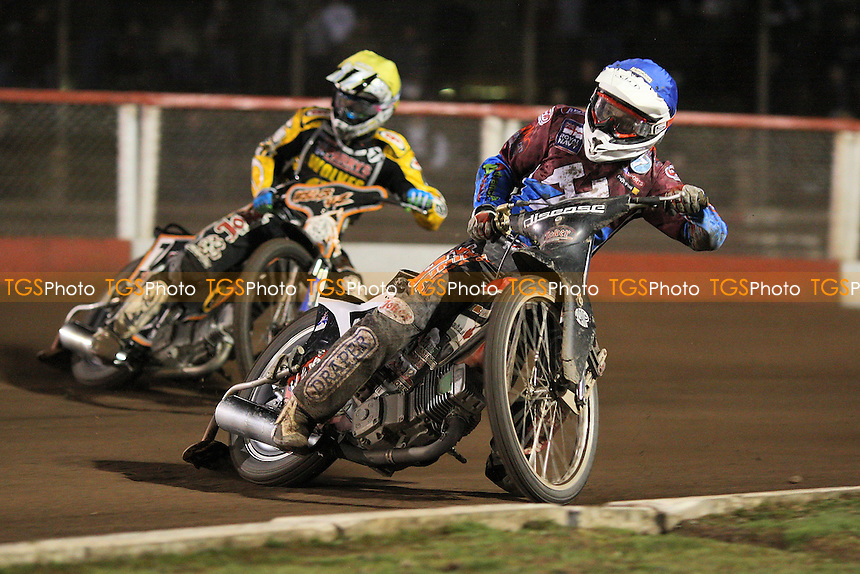 Heat 11: Kyle Legault (blue) ahead of Ricky Wells - Lakeside Hammers vs Wolverhampton Wolves - Elite League Speedway at Arena Essex Raceway - 01/04/11 - MANDATORY CREDIT: Gavin Ellis/TGSPHOTO - Self billing applies where appropriate - Tel: 0845 094 6026
