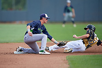 Vermont Lake Monsters shortstop Logan Davidson (3) tags Mason Janvrin (17) out on a stolen base attempt during a NY-Penn League game against the Aberdeen IronBirds on August 18, 2019 at Leidos Field at Ripken Stadium in Aberdeen, Maryland.  Vermont defeated Aberdeen 6-5.  (Mike Janes/Four Seam Images)