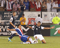 USMNT defender Michael Orozco (4) thwarts attack by Costa Rican forward Jairo Arrieta (22). In CONCACAF Gold Cup Group Stage, the U.S. Men's National Team (USMNT) (blue/white) defeated Costa Rica (red/blue), 1-0, at Rentschler Field, East Hartford, CT on July 16, 2013.