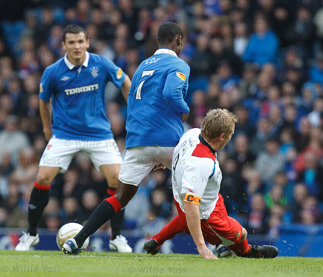 Richie Foran has a late tackle on Maurice Edu injuring the Rangers man's ankle