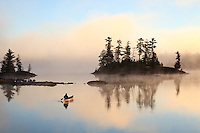 &quot;Paddling to Sunrise&quot;<br /> The canoeist paddles toward the foggy sunrise in the Boundary Waters Canoe Area Wilderness (BWCAW). The wilderness provides an abundance of solitude and serenity for the soul. <br /> <br /> This photograph is from our Canoescapes Series. This photograph was also honored as a finalist in the 12th annual Smithsonian.com photo contest. Of 26,500 entries from photographers in 93 countries, it was one of 10 finalists in the Americana category in 2014.