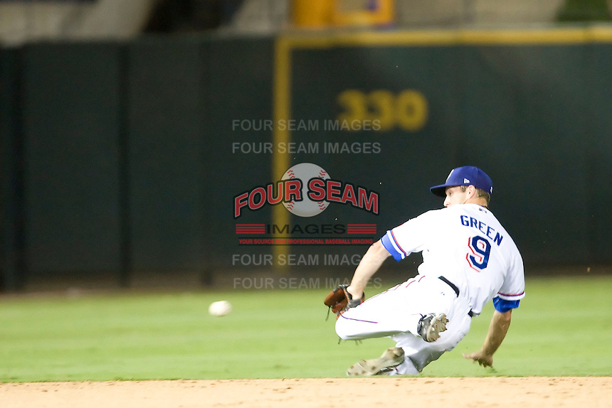 Round Rock Express shortstop Nick Green #9 dives for the ball during a game against the New Orleans Zephyrs at the Dell Diamond on July 21, 2011 in Round Rock, Texas.  New Orleans defeated Round Rock 7-4.  (Andrew Woolley/Four Seam Images)