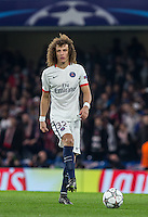 David Luiz of Paris Saint-Germain plays a pass during the UEFA Champions League Round of 16 2nd leg match between Chelsea and PSG at Stamford Bridge, London, England on 9 March 2016. Photo by Andy Rowland.