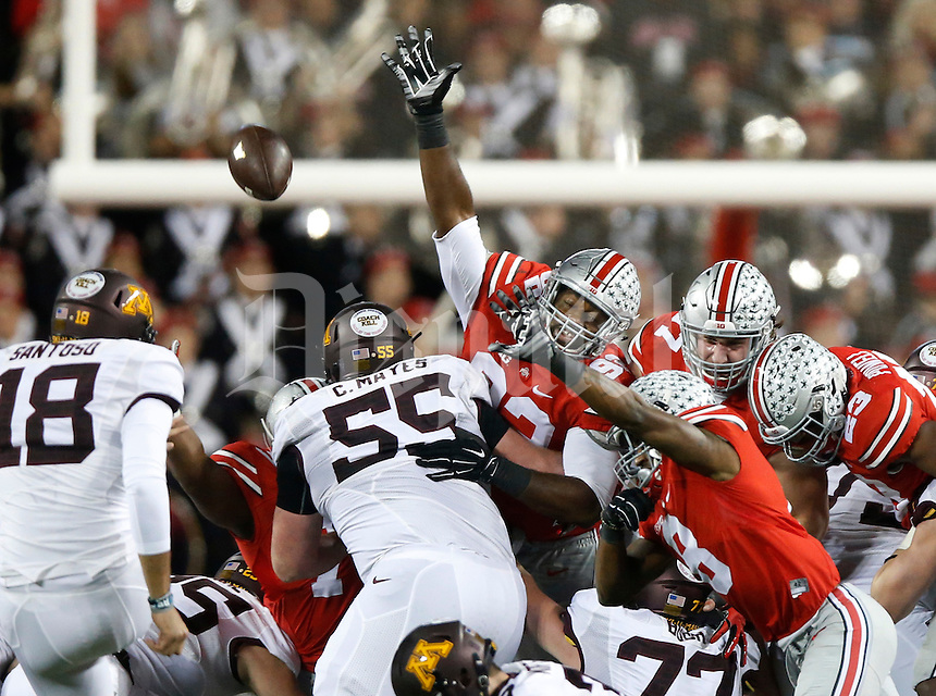Ohio State Buckeyes defensive lineman Adolphus Washington (92) gets a hand up as Minnesota Golden Gophers place kicker Ryan Santoso (18) kicks and misses a field goal attempt   during an NCAA football game between the Ohio State Buckeyes and the Minnesota Golden Gophers at Ohio Stadium on Saturday, November 7, 2015. (Columbus Dispatch photo by Fred Squillante)