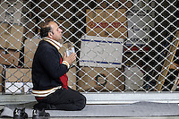 Pictured: A man prays in the passenger station Monday 08 Fabruary 2016<br /> Re: Migrants wait in the Piraeus passenger station to be transported to the migrants' camp in Elliniko, Athens, Greece