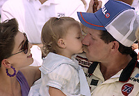 Teresa and Dale Earnhardt celebrate with daughter Taylor Nichole after Dales victory in the Pepsi 400 at Daytona International Speedway, Daytona Beach, FL, July 7, 1990 (Photo by Brian Cleary/www.bcpix.com)