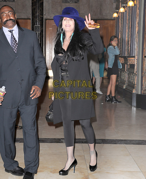 "Cher (Cherilyn Sarkisian).""The Book of Mormon"" Hollywood Opening night Held At The Pantages theatre, Hollywood, California, USA..September 12th, 2012.full length black hat leggings top lace trousers blue purple hand arm waving .CAP/DVS.©DVS/Capital Pictures."