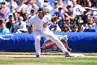 Chicago Cubs second baseman Javier Baez (9) catches a throw covering first during a game against the Milwaukee Brewers on August 14, 2014 at Wrigley Field in Chicago, Illinois.  Milwaukee defeated Chicago 6-2.  (Mike Janes/Four Seam Images)