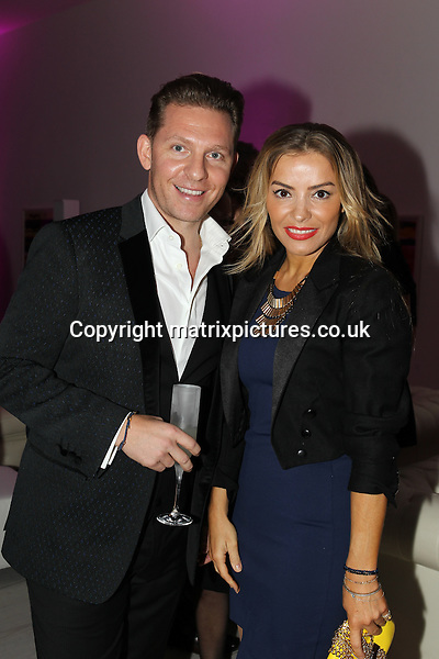NON EXCLUSIVE PICTURE: TREVOR ADAMS / MATRIXPICTURES.CO.UK<br /> PLEASE CREDIT ALL USES<br /> <br /> WORLD RIGHTS<br /> <br /> British luxury property developer Nick Candy and former WAG, Elen Rivas attending the CANDY Magazine Autumn/Winter 2013 Launch Party, hosted by Nick Candy at the Saatchi Gallery in King's Road, London.<br /> <br /> OCTOBER 15th 2013<br /> <br /> REF: MTX 136759