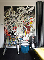 A modern artwork dominates one wall of the master bedroom