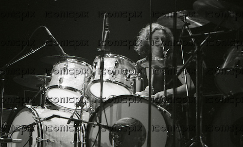 FOREIGNER - drummer Dennis Elliott - performing live at The Rainbow Theatre in London UK - 27 Apr 1978.  Photo credit: George Bodnar/IconicPix