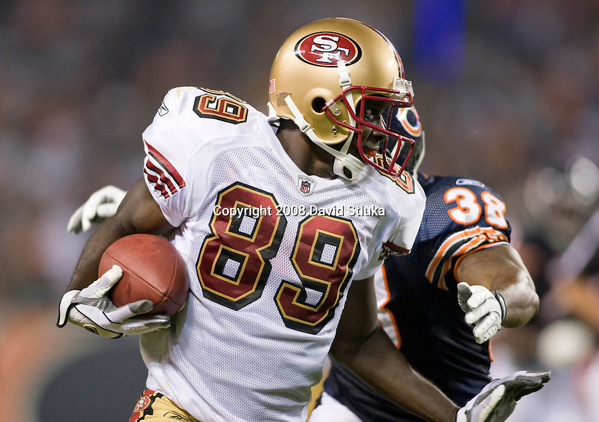 Wide receiver Jason Hill #89 of the San Francisco 49ers gains yardage after a reception against the Chicago Bears at Soldier Field on August 21, 2008 in Chicago, Illinois. The 49ers defeated the Bears 37-30. (AP Photo/David Stluka)