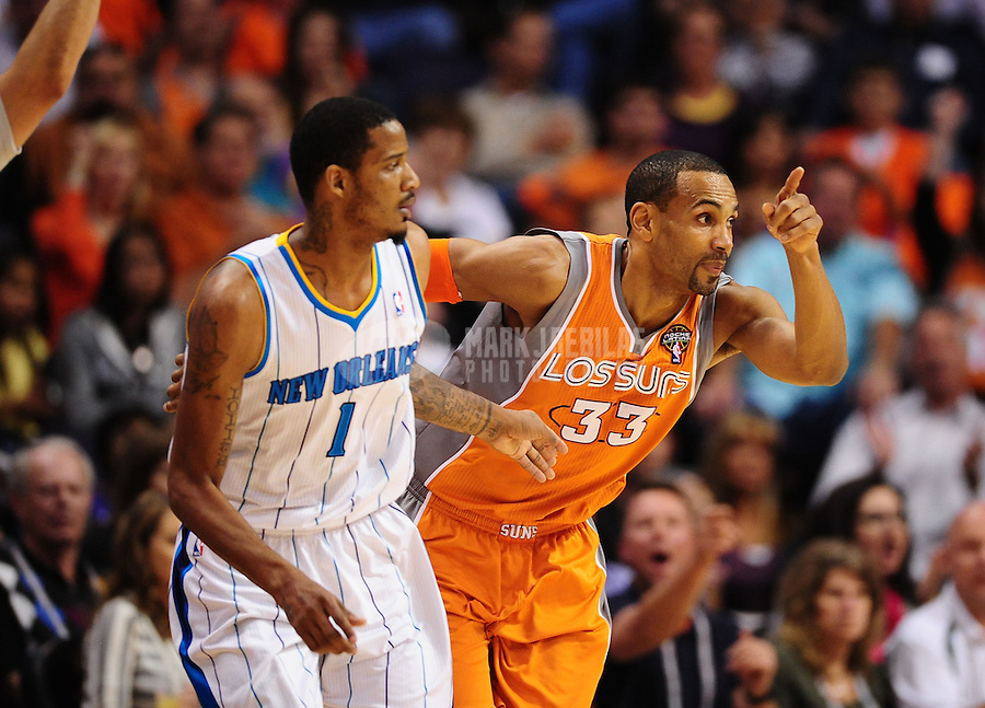 Mar. 25, 2011; Phoenix, AZ, USA; Phoenix Suns forward (33) Grant Hill against New Orleans Hornets forward (1) Trevor Ariza at the US Airways Center. The Hornets defeated the Suns 106-100. Mandatory Credit: Mark J. Rebilas-.