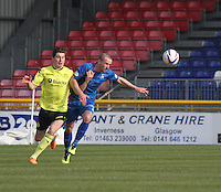Kenny McLean challenges James Vincent in the Inverness Caledonian Thistle v St Mirren Scottish Professional Football League Premiership match played at the Tulloch Caledonian Stadium, Inverness on 29.3.14.