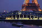 A closed up night view of Eiffel Tower la tour eiffel with river Seine and Basilica of the Sacré Coeur. city of Paris. Paris. France