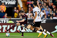 1st February 2020; Mestalla, Valencia, Spain; La Liga Football,Valencia versus Celta Vigo; Iago Aspas of Celta is challenged by Ezequiel Garay and Garbiel Paulista of Valencia CF