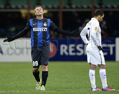 14.03.2013. Milan, Italy. Europa League second leg tie, Inter Milan versus Tottenham Hotspur. Photo shows as Antonio Cassano celebrates his goal for Inter and Lennon looks glum
