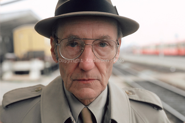 American author William Burroughs at railway station in Bourges, France.