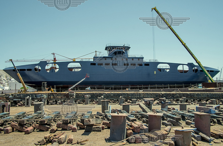A ship being constructed in one of the few shipyards still operating in the once prosperous ship building port.