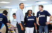 """United States President Barack Obama participates in a service project with """"Armed Services YMCA: Operation Kid Comfort"""" at the Ronald H. Brown Middle School in Washington, DC in honor of the national day of service to commemorate the 9th anniversary of the September 11, 2001 terrorist attacks..Credit: Olivier Douliery - Pool via CNP"""