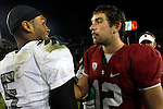 11/12/11--Oregon Ducks quarterback Darron Thomas is congratulated by his friend Stanford quarterback Andrew Luck after the Ducks win over the Cardinal at Stanford Stadium.<br /> <br /> Photo by Jaime Valdez