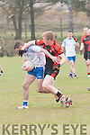 Annascaul Aidan Crean in possession of the ball tackled by Sneem/Derrynane Breandan Teahan during the Junior Premier Championship Qualifier match at the Paddy Kennedy Memorial Park, Annascaul, on Sunday afternoon.