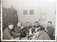 BNPS.co.uk (01202 558833)<br /> Pic: Jones&Jacob/BNPS<br /> <br /> Party time - LSSAH troops off-duty drinking beer.<br /> <br /> Springtime for Hitler...Chilling album of pictures taken by one of Hitlers bodyguards illustrates the Nazi dictators rise to power.<br /> <br /> An unseen album of photographs taken by a member of Hitlers own elite SS bodyguard division in the years leading up to the start of WW2.<br /> <br /> The 1st SS Panzer Division 'Leibstandarte SS Adolf Hitler' or LSSAH began as Adolf Hitler's personal bodyguard in the 1920's responsible for guarding the Führer's 'person, offices, and residences'.
