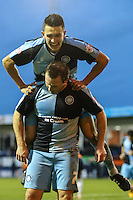 Garry Thompson of Wycombe Wanderers (front) celebrates scoring the opening goal against Luton Town during the Sky Bet League 2 match between Luton Town and Wycombe Wanderers at Kenilworth Road, Luton, England on 26 December 2015. Photo by David Horn.