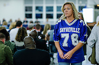 A mom of a Sayreville's student attends a Board of Education meeting for discussing the continuity of the coaches involved in scandal of sexual assault by the school's football team in Parlin, New Jersey 10.21.2014. Photo by Eduardo MunozAlvarez/VIEWpress