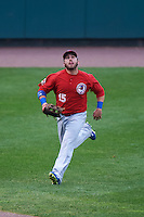 Buffalo Bisons outfielder Caleb Gindl (15) chases down a fly ball that went into the stands during a game against the Rochester Red Wings on July 8, 2015 at Frontier Field in Rochester, New York.  Rochester defeated Buffalo 6-5.  (Mike Janes/Four Seam Images)