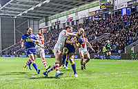 Picture by Allan McKenzie/SWpix.com - 09/03/2018 - Rugby League - Betfred Super League - Warrington Wolves v St Helens - Halliwell Jones Stadium, Warrington, England - Warrington's Mitch Brown is tackled by St Helens's Louie McCarthy-Scarsbrook.