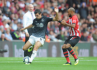 Burnley's Jack Cork under pressure from Southampton's Nathan Redmond<br /> <br /> Photographer Kevin Barnes/CameraSport<br /> <br /> The Premier League - Southampton v Burnley - Sunday August 12th 2018 - St Mary's Stadium - Southampton<br /> <br /> World Copyright &copy; 2018 CameraSport. All rights reserved. 43 Linden Ave. Countesthorpe. Leicester. England. LE8 5PG - Tel: +44 (0) 116 277 4147 - admin@camerasport.com - www.camerasport.com