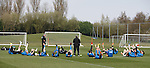Rangers players having a stretch in the sun