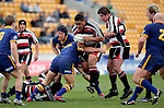 Poaloi Taula tries to break through Callum Bruces tackle during the  Air NZ Cup game between Counties Manukau & Otago played at Mt Smart Stadium,Auckland on the 29th of July 2006. Otago won 23 - 19.