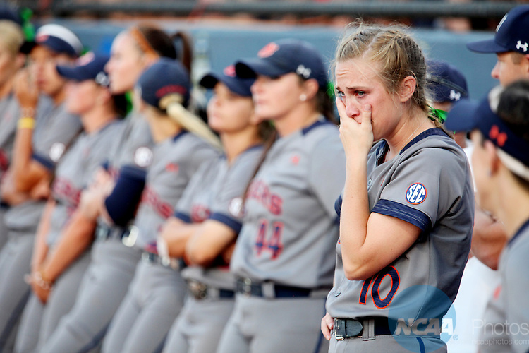 08 JUNE 2016:  Auburn catcher Anna Gibbs (10) looks on as Oklahoma is presented with the National Championship trophy during the Division I Women's Softball Championship is held at ASA Hall of Fame Stadium in Oklahoma City, OK.  Oklahoma defeated Auburn 2-1. Shane Bevel/NCAA Photos