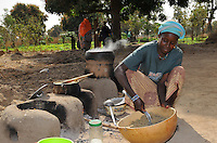 Farmer cooking millet cous- cous using improve stove