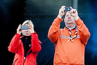 Camp chiefs Marie Reinicke and Göran Hägerdal are filming the crowd by the stage at the opening ceremony. Photo: Kim Rask/Scouterna