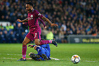 Raheem Sterling of Manchester City is tackled by Sean Morrison of Cardiff City during the Fly Emirates FA Cup Fourth Round match between Cardiff City and Manchester City at the Cardiff City Stadium, Wales, UK. Sunday 28 January 2018
