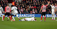 Pictured: Jay Fulton of Swansea, injured on the ground Sunday 01 February 2015<br />