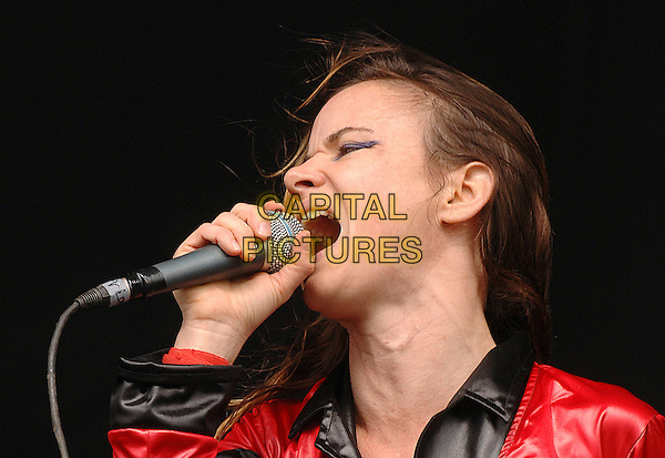 JULIETTE LEWIS & THE LICKS.Performing live at the V Festival, Hylands Park, Chelmsford, England..August 18th, 2007.stage concert live gig performance music headshot portrait  microphone singing .CAP/BEL.©Belcher/Capital Pictures