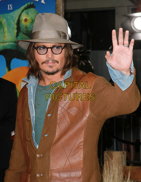 "JOHNNY DEPP.""Rango"" Los Angeles Premiere held At The Regency Village Theatre, Westwood, California, USA..February 14th, 2011.half length jeans grey gray hat glasses goatee facial hair brown leather jacket blue green shirt t-shirt hand arm waving palm.CAP/ADM/KB.©Kevan Brooks/AdMedia/Capital Pictures."