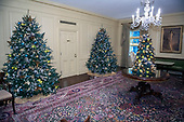 "The 2018 White House Christmas decorations, with the theme ""American Treasures"" which were personally selected by first lady Melania Trump, are previewed for the press in Washington, DC on Monday, November 26, 2018.  This is a wide view of the Vermeil Room showing the Christmas trees and the portrait of former first lady Jacqueline Bouvier Kennedy. <br /> Credit: Ron Sachs / CNP"