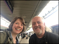 BNPS.co.uk (01202 558833)<br /> Pic: AllTheStations/BNPS<br /> <br /> Vicki meets Bill Bailey.<br /> <br /> A pair of railway enthusiasts are on an epic train journey to become the first people to visit every station in Britain. <br /> <br /> Eccentrics Geoff Marshall, 44, and Vicki Pipe, 34, are three weeks into the adventure, which will see them visit 2,563 stations in just three months. <br /> <br /> The couple of seven years from London began in Penzance and have already visited 750 stations, covering the entire South, South West and much of London. <br /> <br /> After visiting an average of 30 stations per day their trip will conclude in August in Thurso, the British mainland's most northernmost town.
