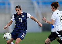 US's Ali Krieger fights for the ball with Germany's Verena Faibt during their Algarve Women's Cup soccer match at Algarve stadium in Faro, March 13, 2013.  .Paulo Cordeiro/ISI