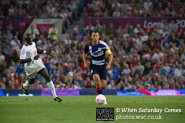 Uruguay 2 United Arab Emirates 1, Great Britain 1 Senegal 1, 26/07/2012. Old Trafford, Olympic Games. Great Britain's captain Ryan Giggs (blue shirt) running with the ball at Manchester United's Old Trafford stadium during his team's opening Men's Olympic Football tournament match at the venue. The double header of matches resulted in Uruguay defeating the United Arab Emirates by 2-1 while Great Britain and Senegal drew 1-1. Over 72,000 spectators attended the two Group A matches. Photo by Colin McPherson.